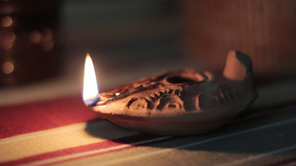 """A clay """"lamp"""" that holds """"oil"""" that gives """"light"""" into a darkened world."""