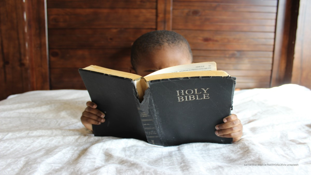Boy reading old Bible